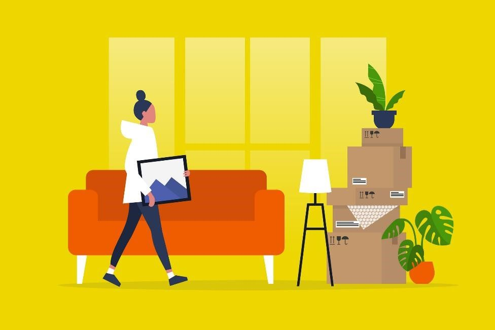 Woman moving red couch, storage boxes, and plants into climate controlled storage unit.