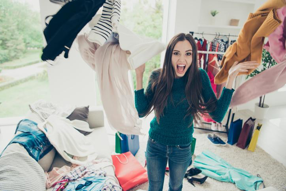 woman decluttering clothes