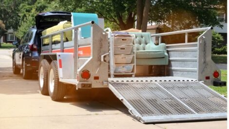 Moving truck carrying furniture.