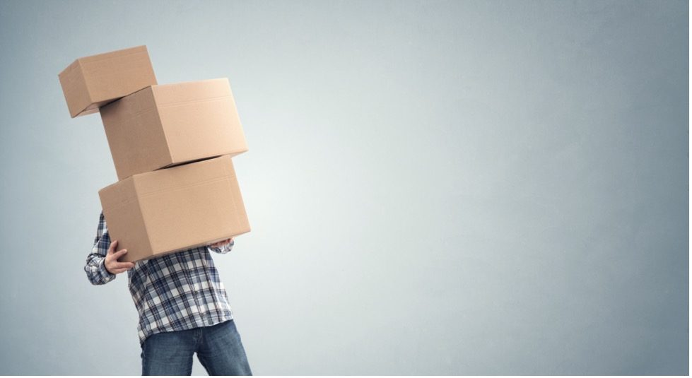 Person carrying boxes.